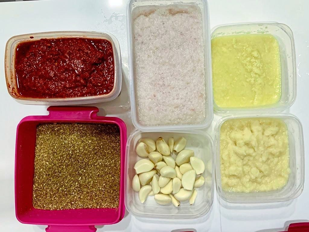 Nazliyah has had to get organised in the kitchen and now spends the weekends cutting, peeling and blending ingredients like garlic, chillies and onions so that she doesn't waste time doing this on the weekdays. — NAZLIYAH MOHD ALI
