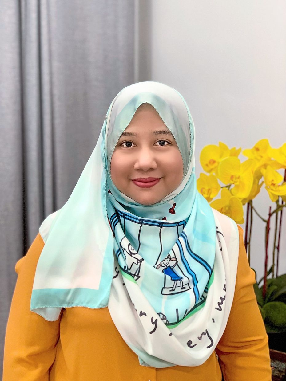 Nazliyah tries to ask her kids what they would like to eat, as her youngest child is a bit particular about food. — NAZLIYAH MOHD ALI
