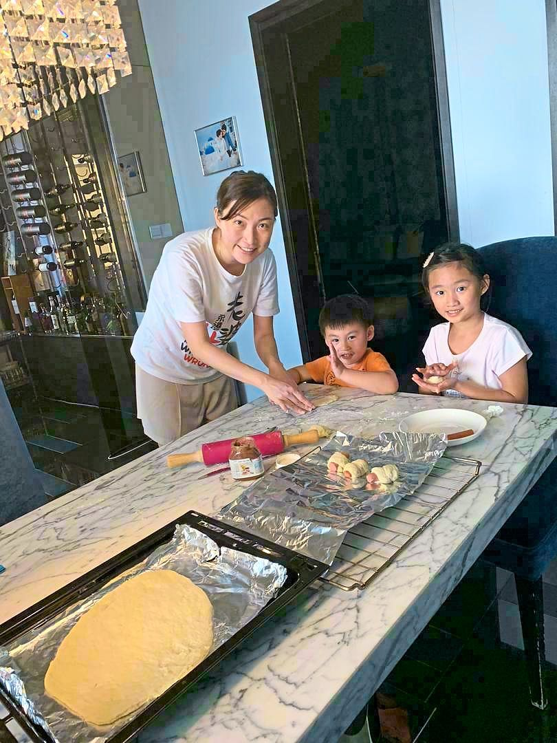 If Ng is particularly busy with meetings and other work commitments, he recruits his wife Denise Chong (pictured here) to help him make the family meals. — RAYMOND NG