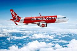 AirAsia Malaysia starts flying again, passengers need to bring own masks