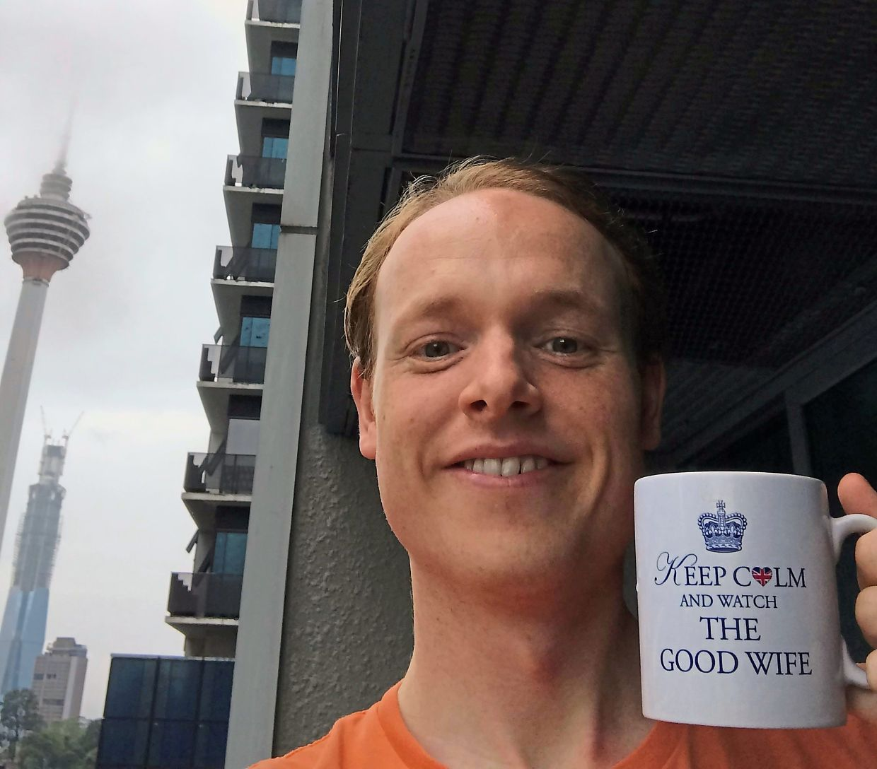 Dickson starts his day with breakfast and coffee on his balcony with a view of Menara Kuala Lumpur. Photo: Craig Dickson