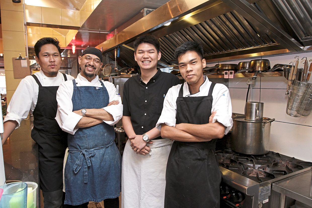 Rai (second from left) says his restaurant has seen a 90% drop in sales since the MCO was enforced. — Filepic