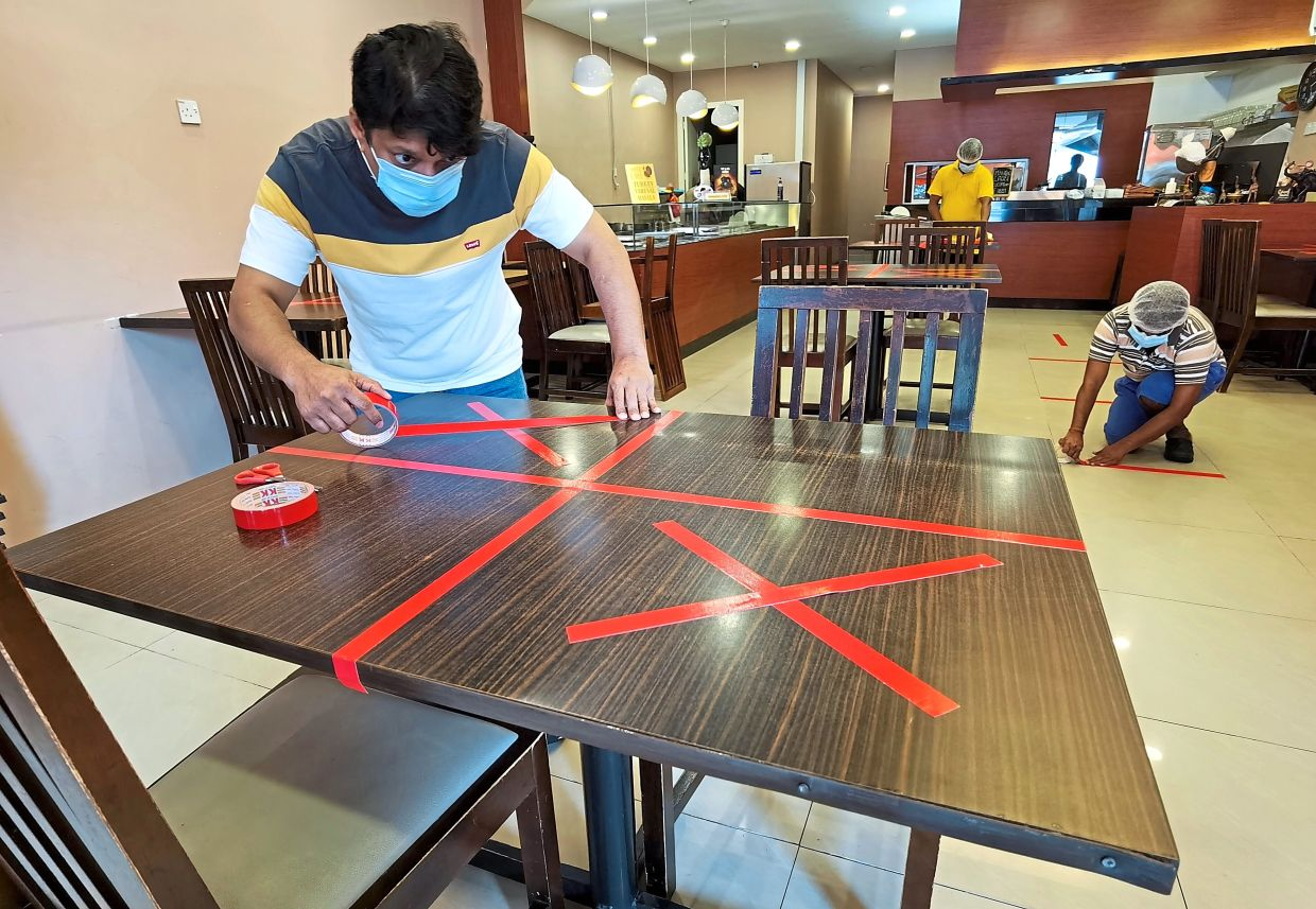 Restaurateurs welcome dine-in move despite strict guidelines | The Star