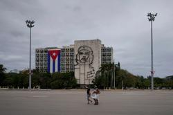 Communist-run Cuba dedicates subdued May Day to 'white coat army' of doctors