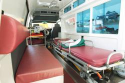 Woman rushes home in an ambulance for father's funeral