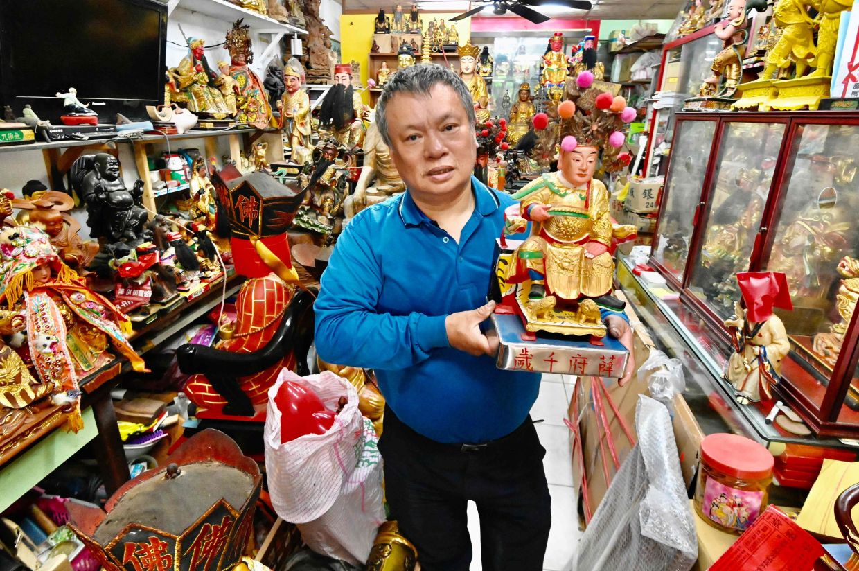 'I hope to find new homes for the statues so the deities can be worshipped and people can form connections with them,' says Lin. Photo: AFP