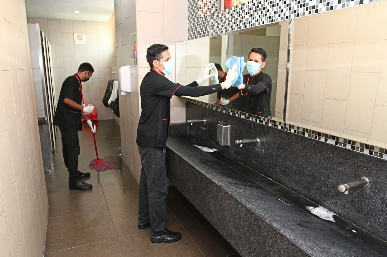Workers cleaning toilets in Summit USJ mall.