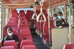 Public transport users follow strict preventive measures