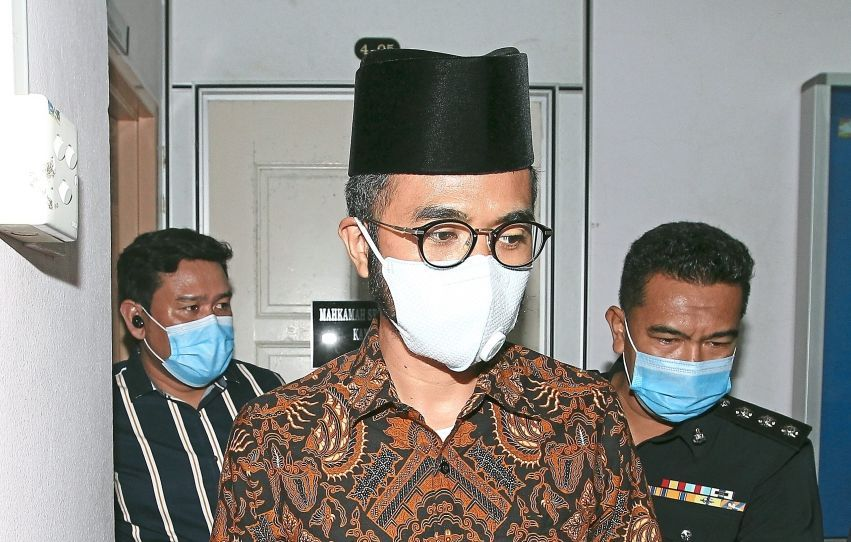 Facing the law: Wak Doyok arriving at the Johor Baru Sessions Court.