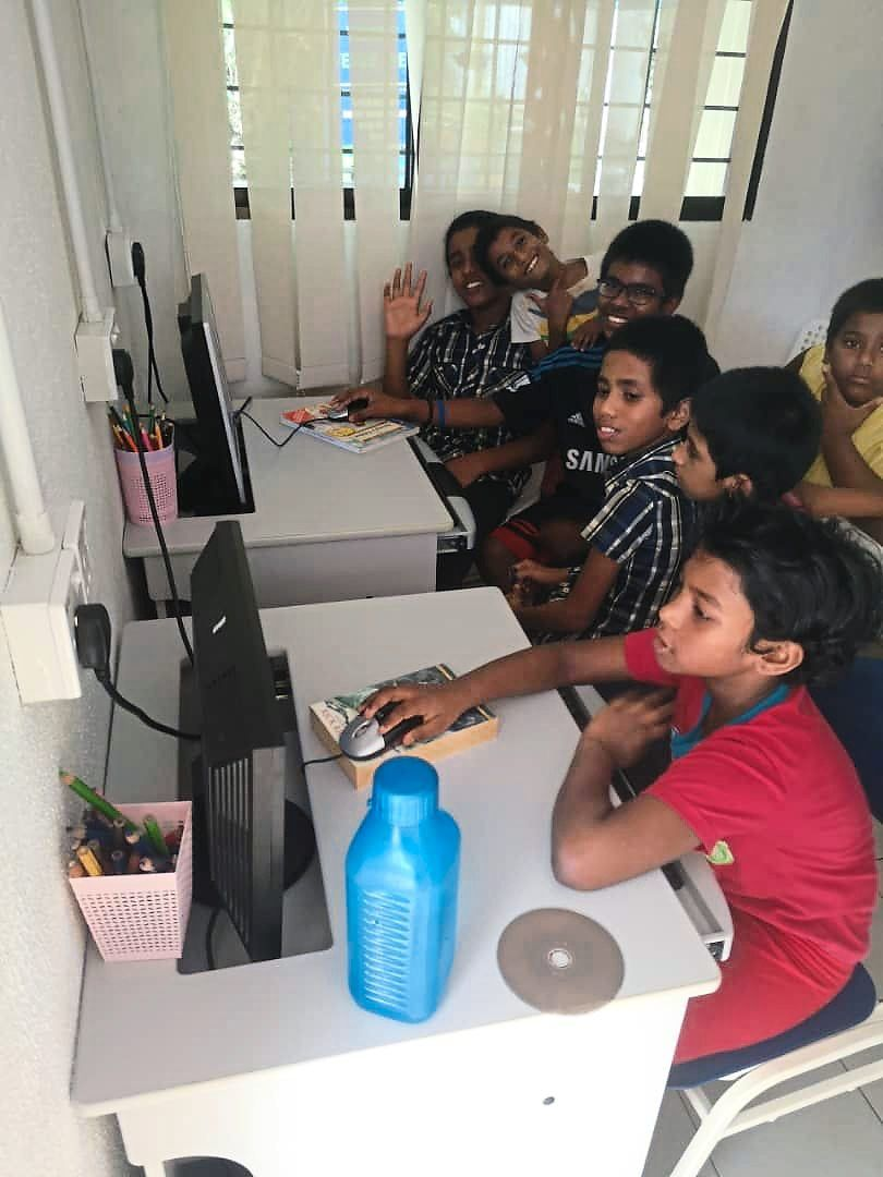 Children  from Vision Home Ipoh doing their schoolwork online.