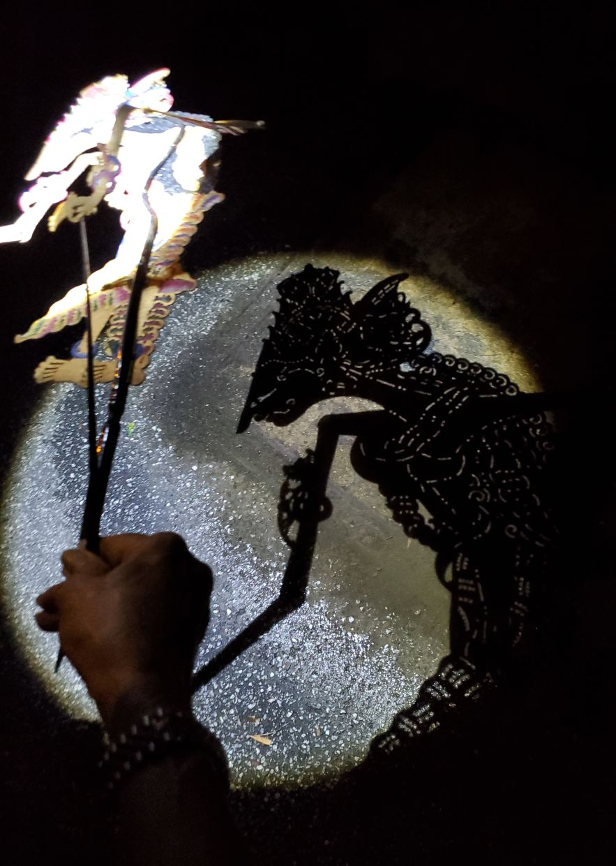 Sabera has been experimenting with different outdoor surfaces and backdrops for the 'Wayang Jalanan' videos. Photo: Masakini Theatre Company