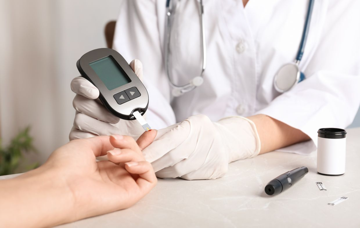 Patient checking on blood sugar level. Diabetes is also the cause of many deaths each year. Photo: Optixanthin Healthcare