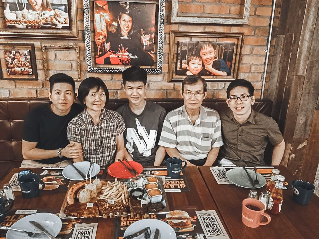 Choo (left) with his family at a mini graduation celebration for his eldest brother, Choo Jun Han (right) in a photo taken before the MCO.