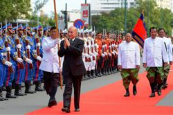Chinese State Councilor visits King of Cambodia in Beijing