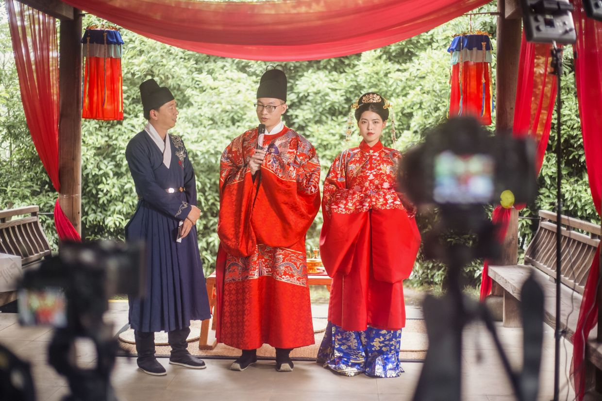 When groom Ma and his bride Zhang got married in the eastern city of Hangzhou on May 1, more than 100,000 impromptu guests watched it live on video-streaming site Bilibili, leaving likes, comments and virtual coins and gifts. — Beiyin Studio/AFP