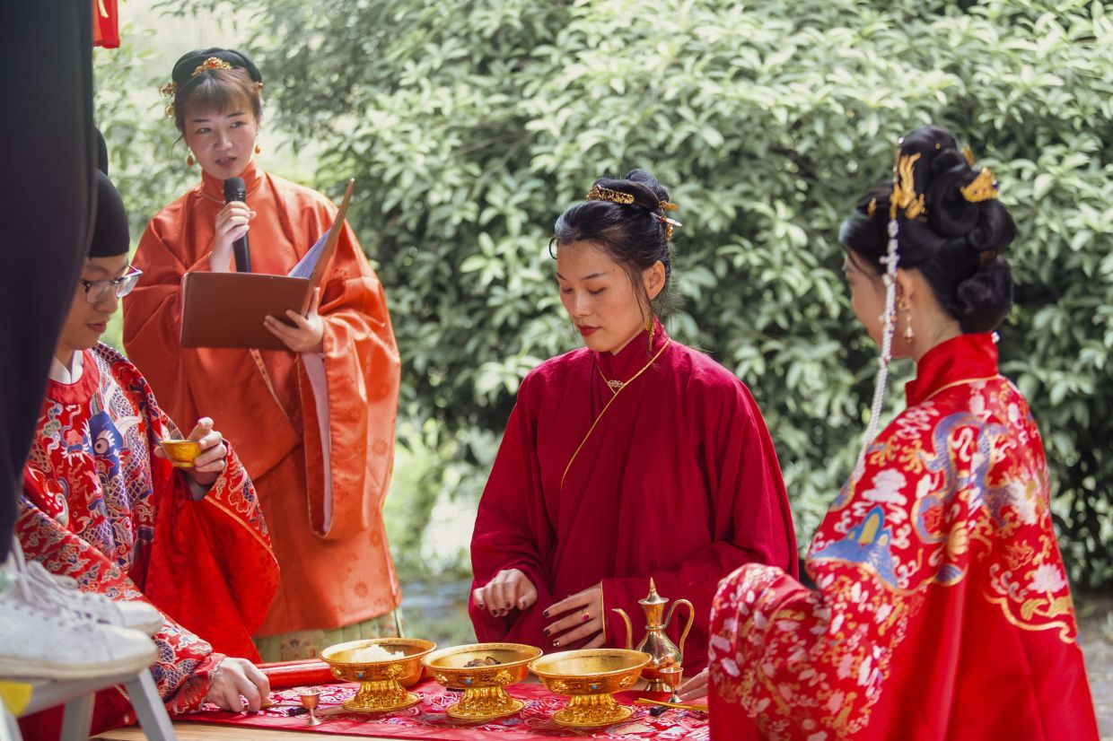 Ma (left) and bride Zhang (right) during their livestreamed wedding ceremony in Hangzhou in China's eastern Zhejiang province. — Beiyin Studio/AFP