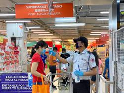 Malls exercise caution as crowds relish chance to buy non-essential items