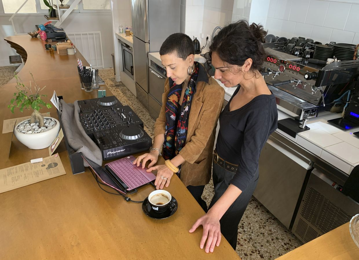 Economopoulou, left, and Kexagia, who run a vegan bistro, checking their laptop in Athens. It took them nearly eight months to get operating permits approved before first opening in February – a process the government says will be considerably accelerated by the end of 2020. — AP
