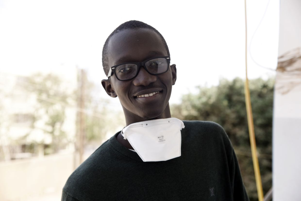 Kébé, a final year mechanical engineering student and coordinator of the 'Dr Car', poses for a portrait in the school's lab.