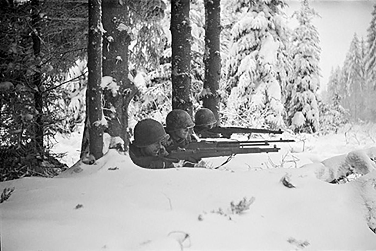 This 1944 photo titled 'Firing Line' by Vaccaro, shows American soldiers in Germany's Hurtgen Forest. Vaccaro was thrown into WWII with the 83rd Infantry division which fought in Normandy. Photo: AP