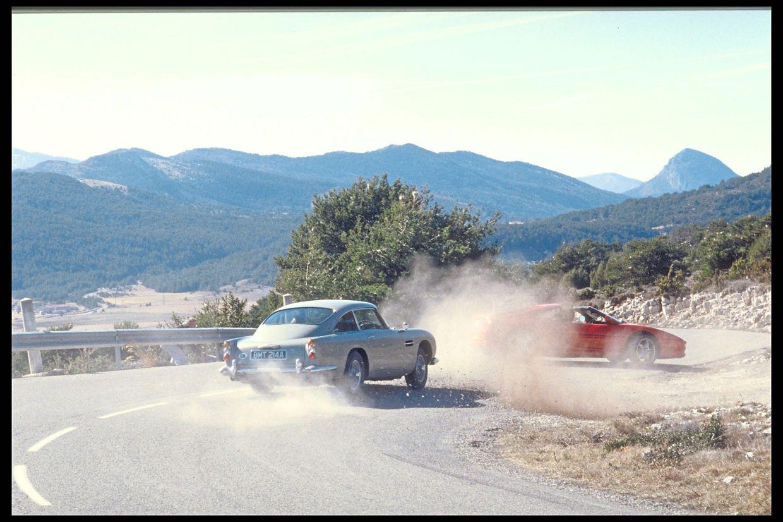 In Goldeneye (1995), James Bond in his Aston Martin DB5 chases the driver Xenia Onatopp, driving a Ferrari F355 GT near Monte Carlo. — Aston Martin/dpa
