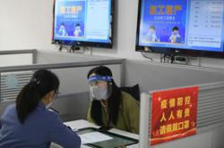 China reports slightly higher unemployment rate in April