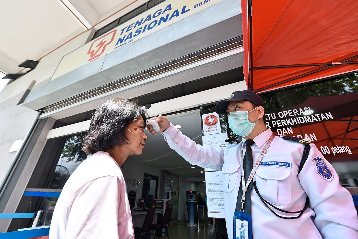 Precautionary measures at Kedai Tenaga include wearing face masks, going through temperature screenings, providing contact details before entering the premises, using the hand sanitiser provided and practising social distancing.