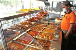 Mamak eateries stick to old prices