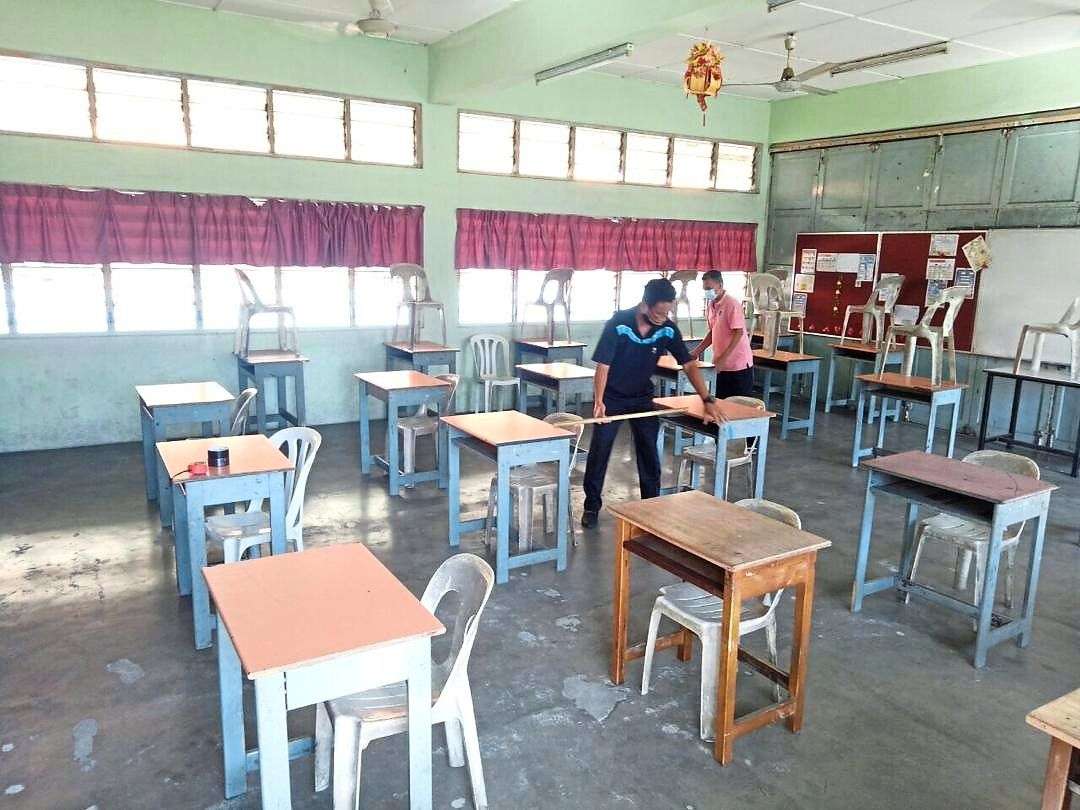 Thorough protocols: SMJK Choong Hwa, Bidor, Perak staff follow strict standard operating procedures in their preparation to welcome students back.