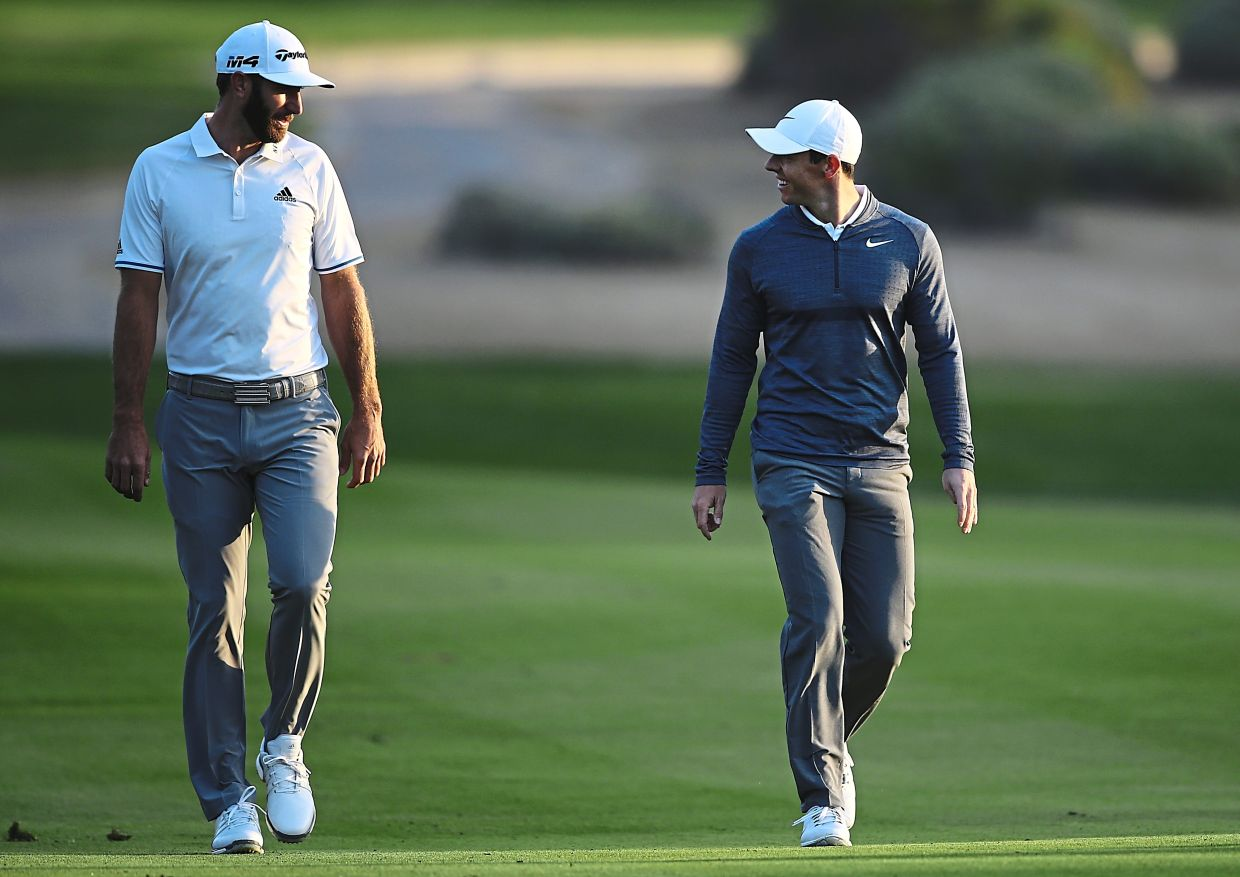Dustin Johnson (left) and Rory McIlroy will be partners in the team event.
