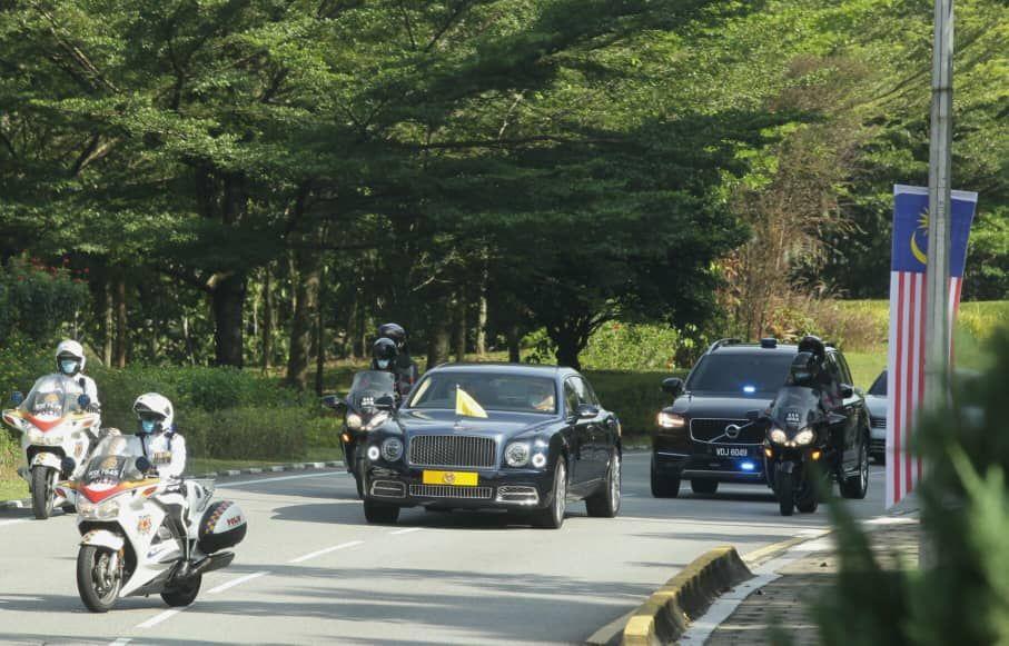 The Yang di-Pertuan Agong arriving at Parliament in his official vehicle.