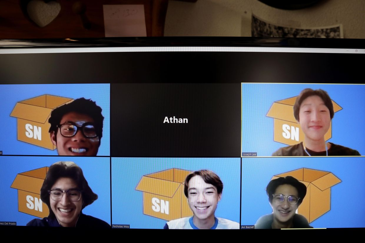 Clockwise from upper left, Valencia High School students, Hayden Lee, 17, Joseph Lee, 16, Fabio Nunez Del Prada, 16, Nicholas Moy, 16, and Avi Basnet, 16, appear for a portrait shoot on a computer screen using Zoom. The students wrote a computer program, SupplyNeighbor.com, that allows people to plug in their zip code, then communicate anonymously with people in their area whom they can ask for help, advice, trade supplies.