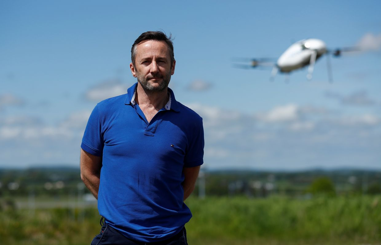 Healy of Manna Aero poses as a drone delivers essential household and medical supplies to the village of Moneygall, following the coronavirus disease (Covid-19) outbreak in Ireland.