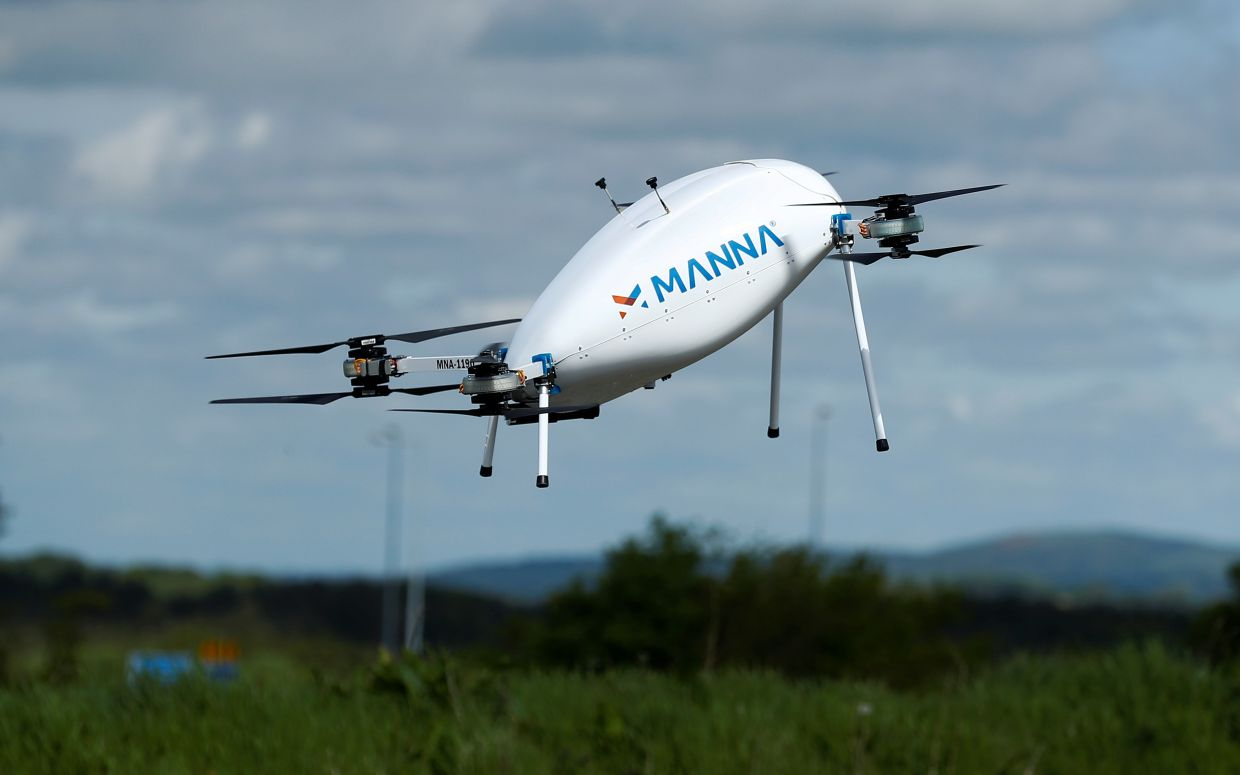 A Manna Aero drone is seen as it delivers essential household and medical supplies in the village of Moneygall.