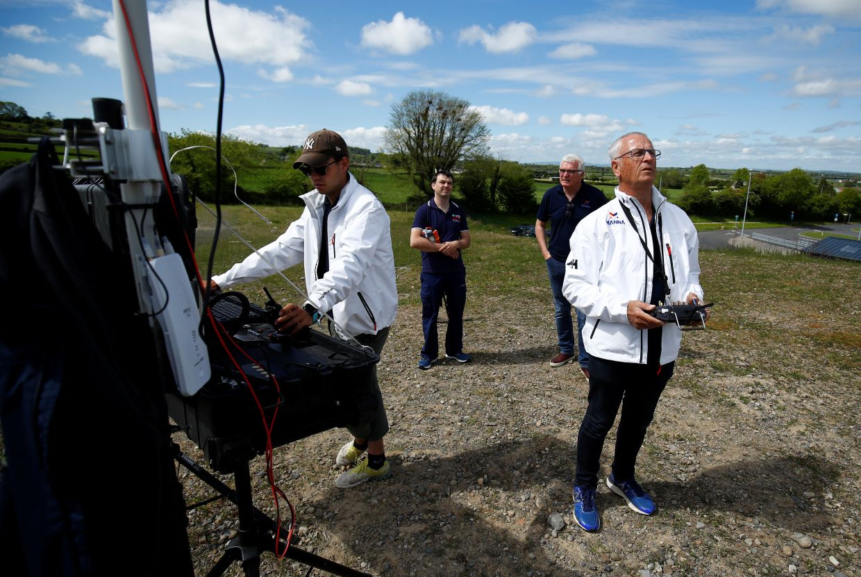 Drone operators from Manna Aero fly the drone as essential household and medical supplies are delivered to the Irish village of Moneygall, following the coronavirus disease (Covid-19) outbreak, in Ireland.