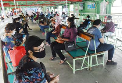 Commuters seen wearing face mask on board the ferry across the channel from Sultan Abdul Halim ferry terminal in Butterworth to Raja Tun Uda ferry terminal in Penang. during the CMCO. MUSTAFA AHMAD/The Star