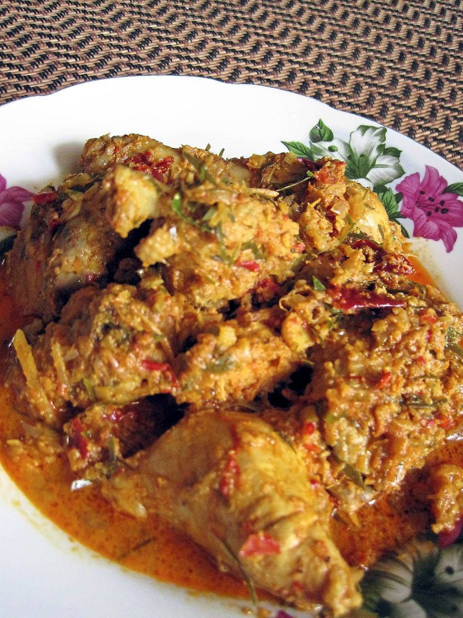 In most versions of rendang, either beef or chicken is used alongside spices, herbs,  coconut milk and kerisik. — Filepic