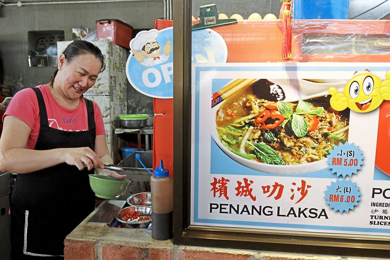Hawker Chuah Lay Ping, 42, preparing laksa for customers at Weld Quay.