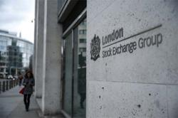 China urges its firms to list in London