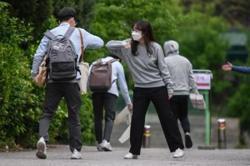 Schools reopen in South Korea as Covid-19 fears ease