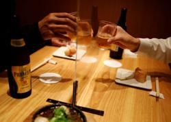 Japanese pub aims to clean up with disinfectant spray machine
