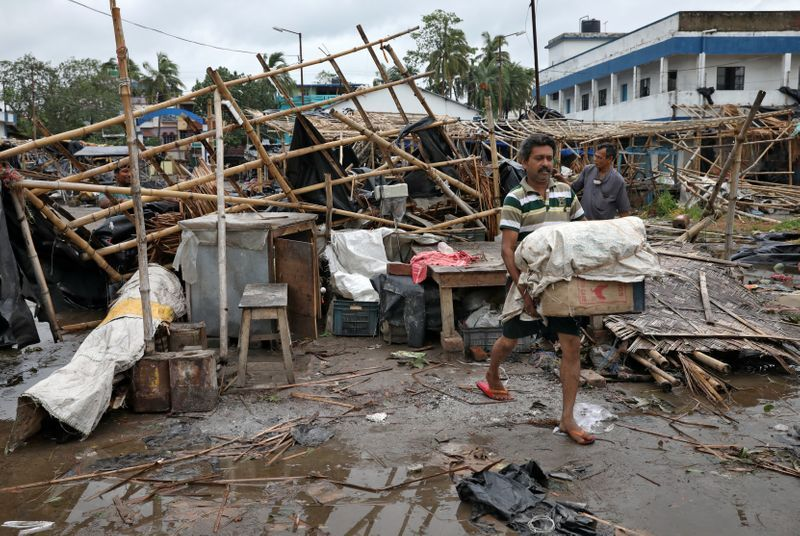 A man salvages his belongings from the rubble of a damaged shop after Cyclone Amphan made its landfall in South 24 Parganas district in the eastern state of West Bengal India May 21 2020. REUTERSRupak De Chowdhuri