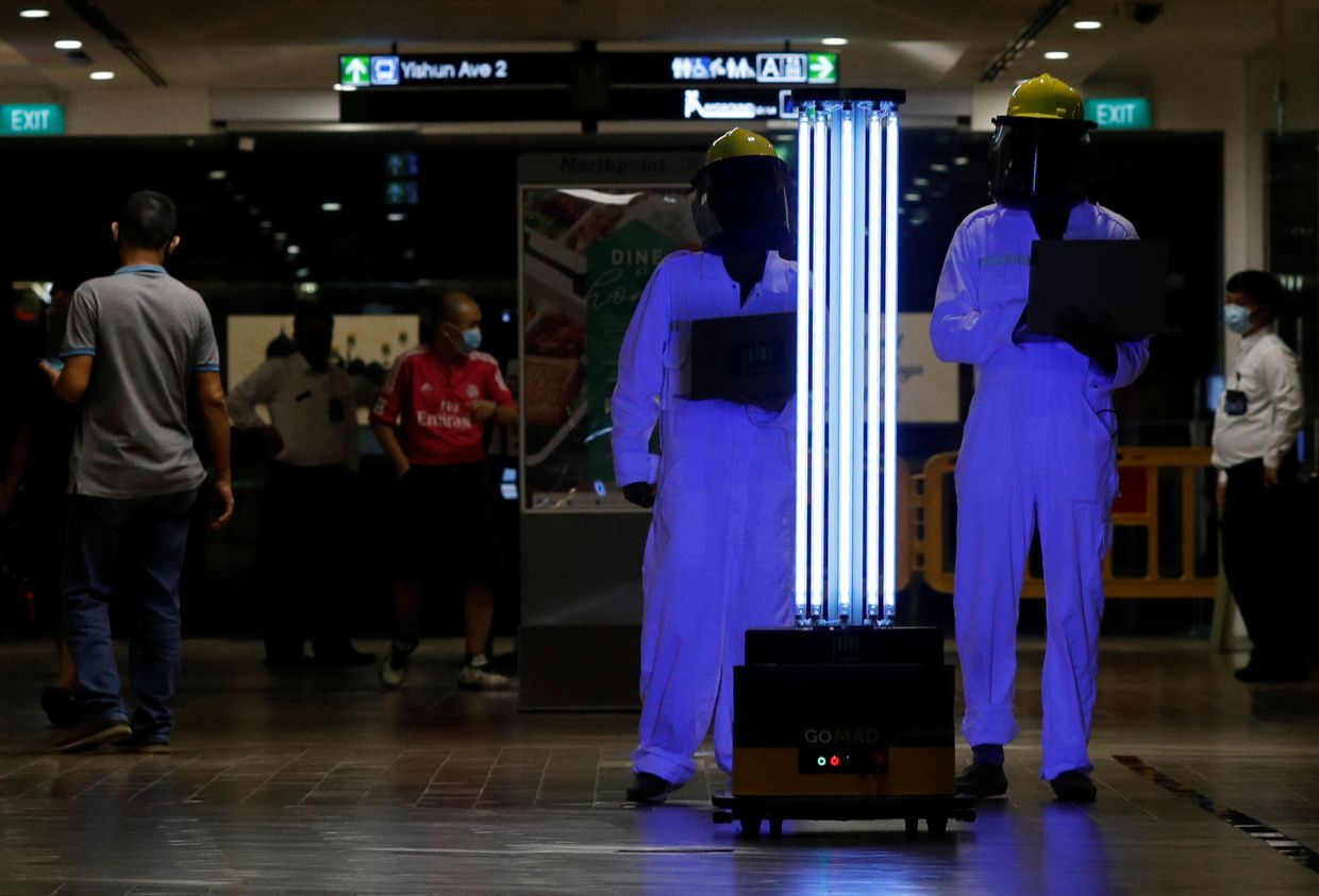 An autonomous mobile robot that disinfects surfaces with ultraviolet light, known as Sunburst UV Bot, is deployed at Northpoint City shopping mall amid the coronavirus disease (Covid-19) outbreak in Singapore. — Reuters