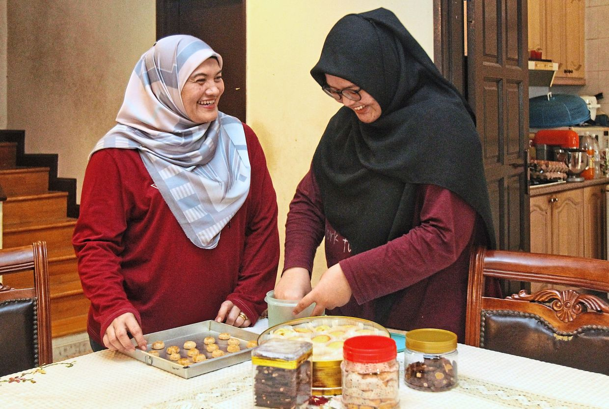 Wan Zurainah cherishes the chance to spend time with her daughter Amira during the MCO.