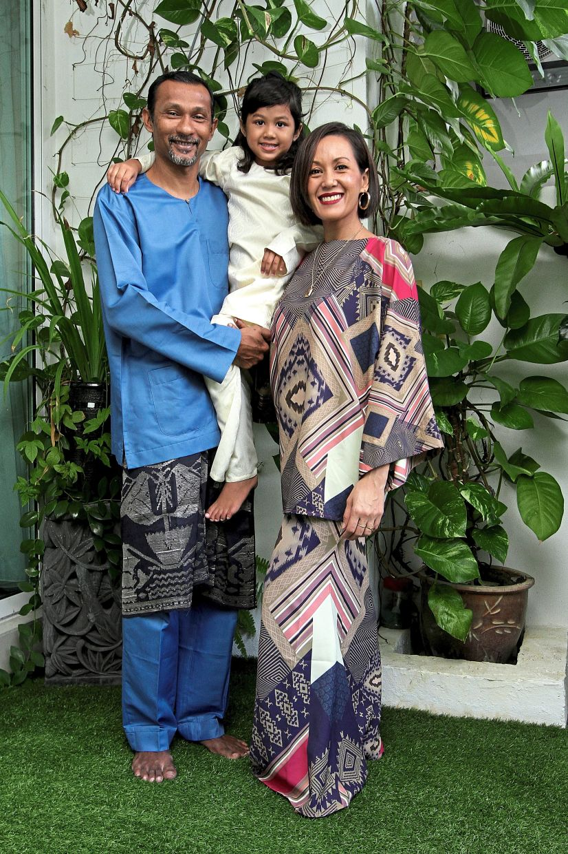 Hari Raya is about family bonding. From left: Kevin Isitor, Kaira-Anne and Iza Ibrahim