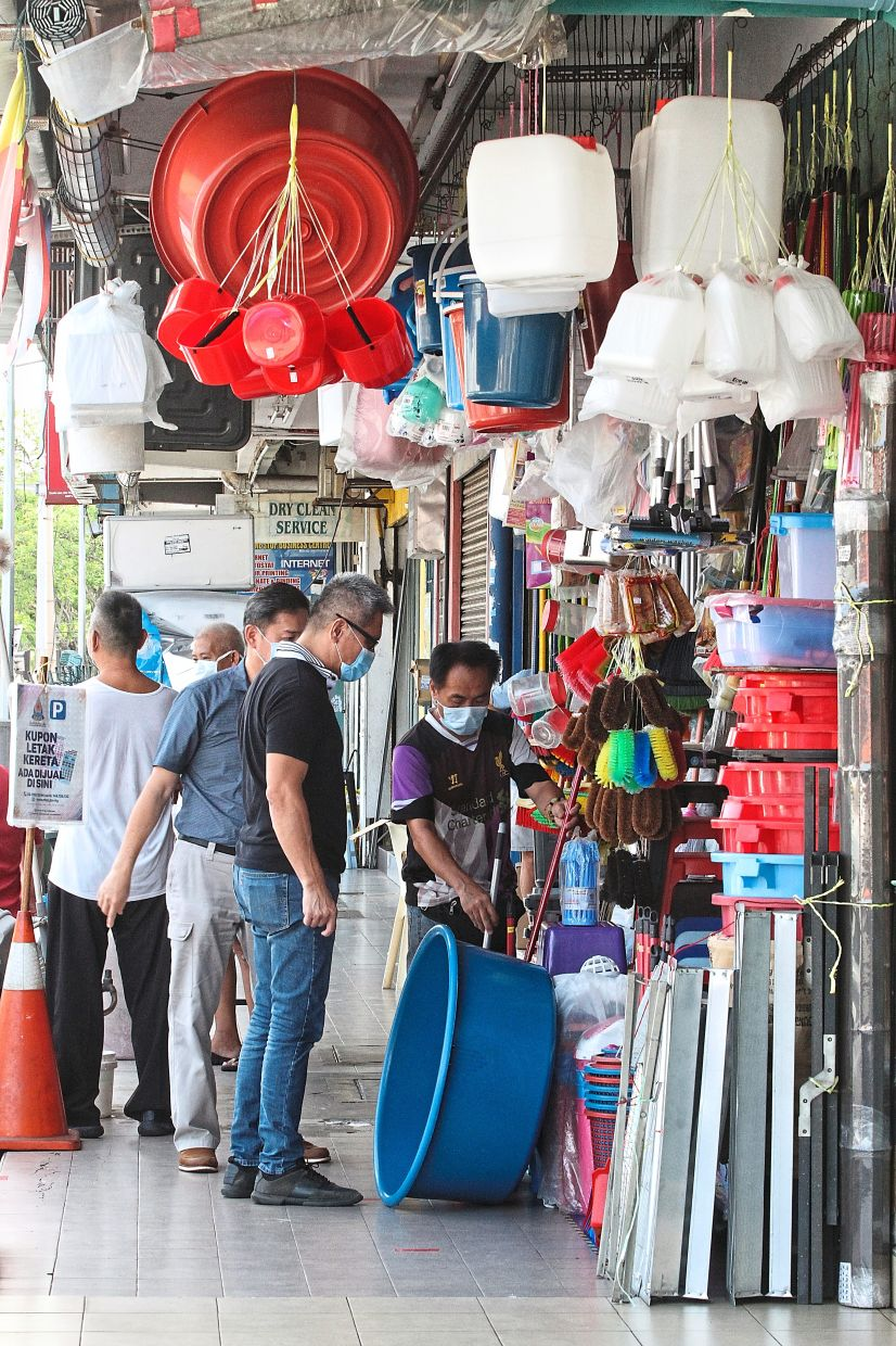 Some businesses resumed after the enhanced MCO in PJ Old Town was lifted. — SAM THAM/The Star