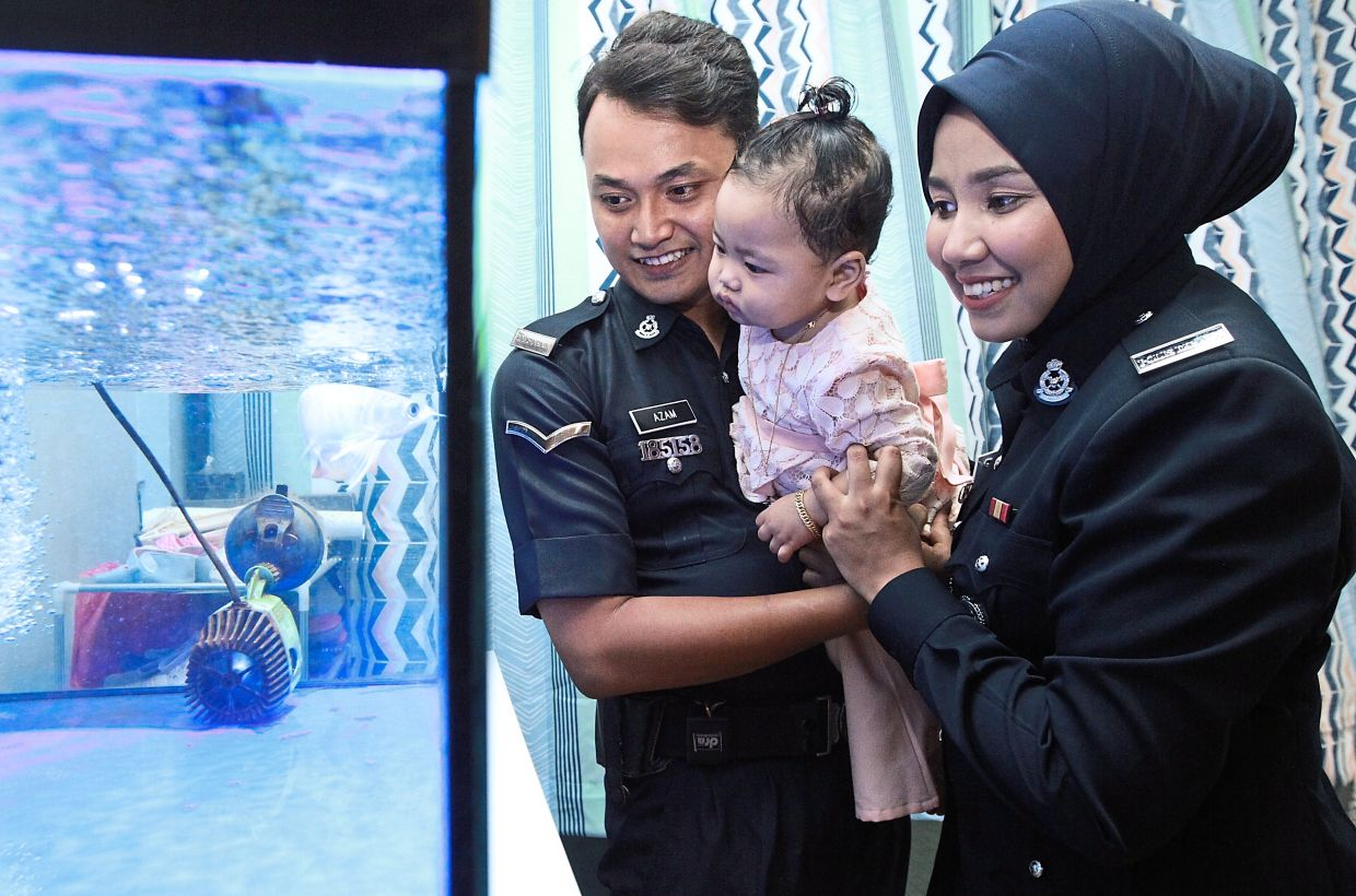 Samniatun and Azam will leave their child with a neighbour if they are required to work during Raya.