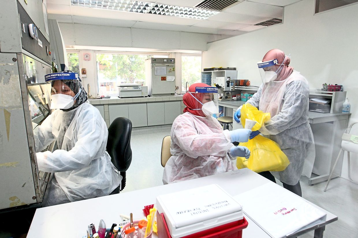 The IMR lab for Covid-19 sample deactivation and RNA isolation. Labs testing the coronavirus should have the proper safety procedures and protocols in place. — Filepic