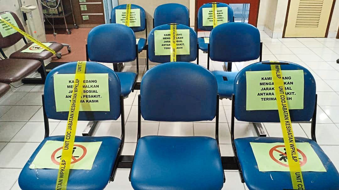 Public health clinics are taking all due precautions to help prevent the spread of Covid-19, including marking off chairs to help maintain social distancing.