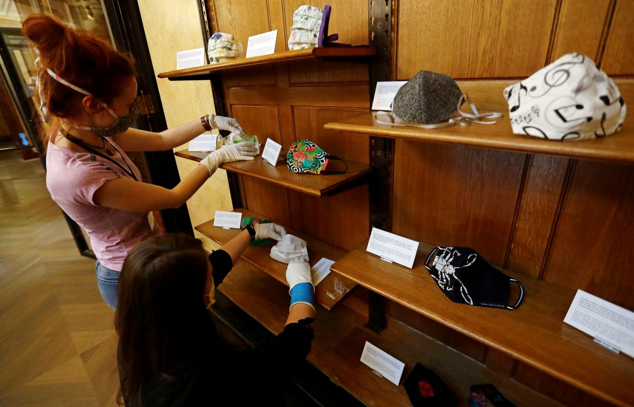 Museum staff prepare the face mask exhibits at the Czech National Museum in Prague. Photo: Reuters